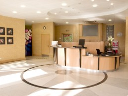Reception area of Nestle offices with radial terazzo floor and bespoke curving ash reception desk
