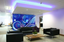 Office interior reception waiting area with downstand ceiling and bespoke glass artwork panels