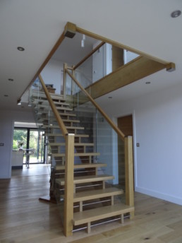 Bespoke Architect designed stairacse in Modern Home from Oak, Glass and aluminium