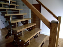 Bespoke Oak, glass and aluminium staircase